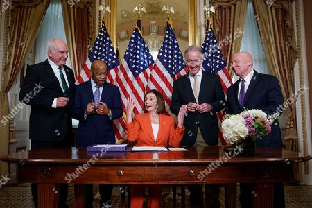 Speaker of the House Nancy Pelosi (C), with Chairman of the House Ways and Means Committee Richard Neal (2-R), Ranking Member of the House Ways and Means Committee Kevin Brady (R), Chairman of the House Subcommittee on Oversight John Lewis (2-L) and Ranking Member of the House Subcommittee on Oversight Mike Kelly (L), delivers remarks during a bill enrollment ceremony for H.R. 3151 - the Taxpayer First Act in the US Capitol in Washington, DC, USA, 21 June 2019. Speaker Pelosi declined to comment on questions from the news media on Iran noting the bipartisan nature of the enrollment ceremony.