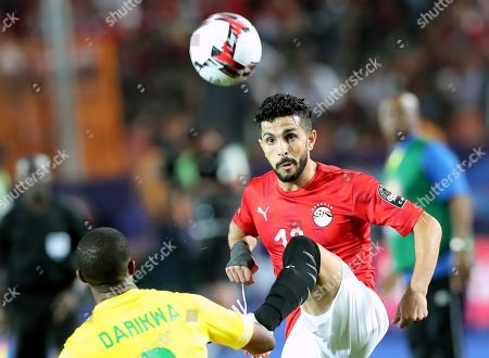 Egyptian player Ayman Ashraf (R) in action against  Zimbabwe  player Tendayi David  (L)  during the opening match of the 2019 Africa Cup of Nations (AFCON) between Egypt and Zimbabwe at Cairo International Stadium in Cairo, Egypt, 21 June 2019. The 2019 Africa Cup of Nations (AFCON) will take place from 21 June until 19 July 2019 in Egypt.