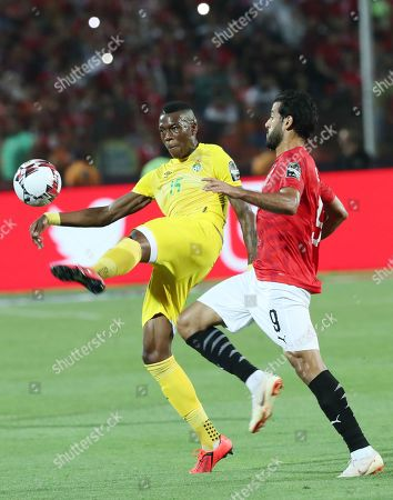 Egyptian player Marwan Mohsen R) in action against Zimbabwe player Teenage Lingani  (L)  during the opening match of the 2019 Africa Cup of Nations (AFCON) between Egypt and Zimbabwe at Cairo International Stadium in Cairo, Egypt, 21 June 2019. The 2019 Africa Cup of Nations (AFCON) will take place from 21 June until 19 July 2019 in Egypt.