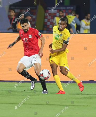 Egyptian playyer Ayman Ashraf (L) in action against  Zimbabwe  player Oviidy Obviuos Karuru (R)  during the opening match of the 2019 Africa Cup of Nations (AFCON) between Egypt and Zimbabwe at Cairo International Stadium in Cairo, Egypt, 21 June 2019. The 2019 Africa Cup of Nations (AFCON) will take place from 21 June until 19 July 2019 in Egypt.