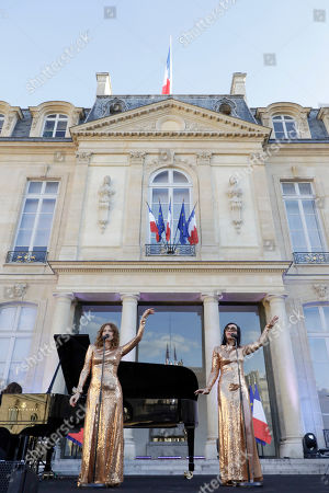 French duo Brigitte with Aurelie Saada, left, and Sylvie Hoarau,perform in the courtyard of the presidential Elysee Palace as part of France's annual music festival in Paris