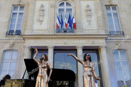 French duo Brigitte with Aurelie Saada, left, and Sylvie Hoarau, perform in the courtyard of the presidential Elysee Palace as part of France's annual music festival in Paris