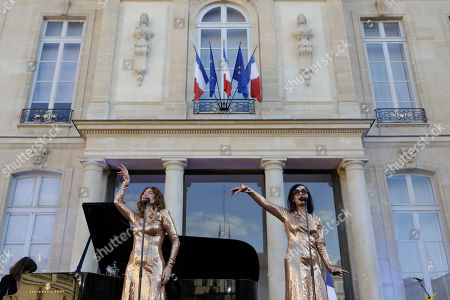 French duo Brigitte with Aurelie Saada, left, and Sylvie Hoarau, perform in the courtyard of the presidential Elysee Palace as part of France's annual music festival in Paris, France, 21 June 2019. Sir Elton John received the Legion of Honor, France's highest award, during a visit to the presidential Elysee Palace.