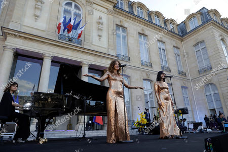 Stock Picture of French duo Brigitte with Aurelie Saada, left, and Sylvie Hoarau,perform in the courtyard of the presidential Elysee Palace as part of France's annual music festival in Paris, France, 21 June 2019. Sir Elton John received the Legion of Honor, France's highest award, during a visit to the presidential Elysee Palace.
