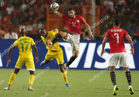 Egypt's Ayman Ashraf right, and Zimbabwe's Nyasha Mushekwi fight for the ball during the group A soccer match between Egypt and Zimbabwe at the Africa Cup of Nations at Cairo International Stadium in Cairo, Egypt