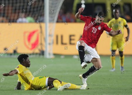 Egypt's Abdallah El Said, right, and Zimbabwe's Marshal Munetsi fight for the ball during the group A soccer match between Egypt and Zimbabwe at the Africa Cup of Nations at Cairo International Stadium in Cairo, Egypt