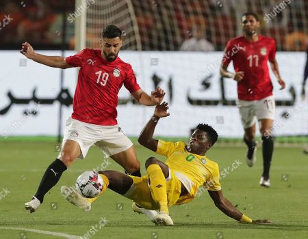Egypt's Abdallah El Said, left, and Zimbabwe's Marshal Munetsi fight for the ball during the group A soccer match between Egypt and Zimbabwe at the Africa Cup of Nations at Cairo International Stadium in Cairo, Egypt