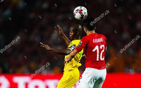 Ayman Ashraf Elsayed of Egypt and Knowledge Musona of Zimbabwe challenging for the ball during the African Cup of Nations match between Egypt and Zimbabwe at the Cairo International Stadium in Cairo, Egypt