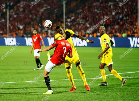 Mahmoud Hamdy Mohamed Attia of Egypt and Talent Chawapihwa of Zimbabwe during the African Cup of Nations match between Egypt and Zimbabwe at the Cairo International Stadium in Cairo, Egypt