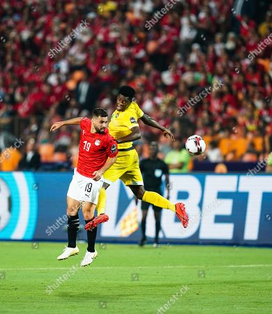 Abdallah Mahmoud Said Mohamed Bekhit of Egypt and Talent Chawapihwa of Zimbabwe G0 during the African Cup of Nations match between Egypt and Zimbabwe at the Cairo International Stadium in Cairo, Egypt