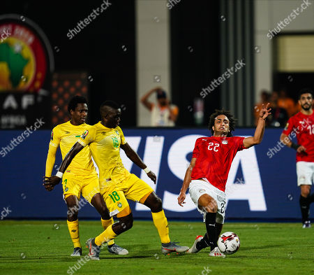 Stock Photo of Amr Medhat Mohsen Warda of Egypt and Marvellous Nakamba of Zimbabwe G0 during the African Cup of Nations match between Egypt and Zimbabwe at the Cairo International Stadium in Cairo, Egypt