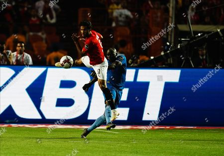 Edmore Sibanda of Zimbabwe clearing the ball in front of Marwan Mohsen Fahmy Tharwat of Egypt during the African Cup of Nations match between Egypt and Zimbabwe at the Cairo International Stadium in Cairo, Egypt