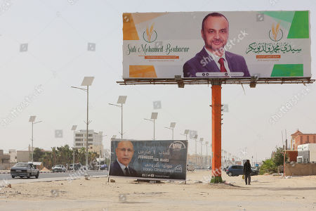 Election posters of Sidi Mohamed Ould Boubacar, former prime minister and candidate for the presidential election (up) and election poster of Mohamed Ould Cheikh Mohamed Ahmed Ghazouani, the ruling party's candidate (down) on a street of Nouakchott, Mauritania, 21 June 2019. Mauritania will vote on 22 June for the first round of a presidential election for a successor to President Mohamed Ould Abdel Aziz, who is stepping down after his second and final term in office.