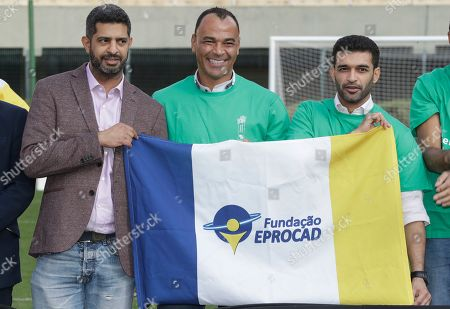 Former Brazilian soccer player Cafu, center, poses for a photo with Hassan Al Thawadi, left, Chairman of the FIFA World Cup Qatar 2022, and Nasser Al-Khater, right, deputy-secretary general of the Qatar 2022 organizing committee, during a event where Cafu was presented as an Ambassador for the World Cup 2022, in Sao Paulo, Brazil