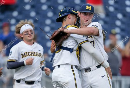 Jeff Criswell, Joe Donovan. Michigan closing pitcher Jeff Criswell, right, is hugged by catcher Joe Donovan following an NCAA College World Series baseball elimination game against Texas Tech in Omaha, Neb., . Michigan won 15-3