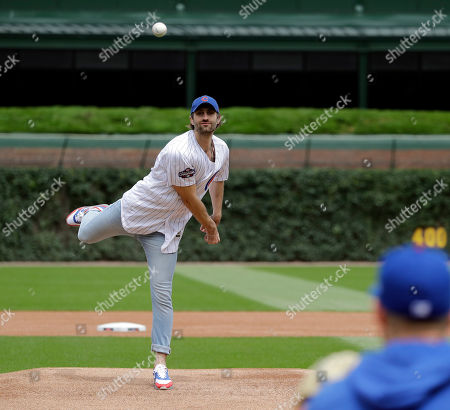 Country music singer Ryan Hurd throws out a ceremonial first pitch before a baseball game between the New York Mets and the Chicago Cubs in Chicago