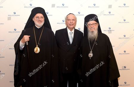 Rabbi Arthur Schneier, center, president and founder of the Appeal of Conscience Foundation and senior rabbi of Park East Synagogue, welcomes Archbishop Elpidophoros, left, the new leader of the Greek Orthodox Archdiocese of America, to New York, joined by Archbishop Demetrios, former leader of the Greek Orthodox Archdiocese of America, to an interfaith gathering of religious leaders and members of the diplomatic community during a reception held at Park East Synagogue