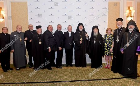Stock Image of Left to right, Archbishop Bernardito Auza, the Very Rev. Leonid Kishkovsky, the Most Rev. Nicholas A. DiMarzio, Metropolitan Augoustinos of Germany, John A. Catsimatidis, Rev. Fr. Alexander Karloutsos, Rabbi Arthur Schneier, Archbishop Elpidophoros, Archbishop Demetrios, Cheryl Fishbein, the Rt. Rev. Irinej Dobrijevic and Archbishop Anoushavan Tanielian, attend an interfaith gathering to welcome Archbishop Elpidophoros, the new leader of the Greek Orthodox Archdiocese of America, to New York, hosted by the Appeal of Conscience Foundation