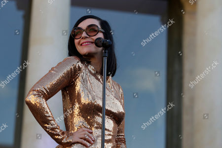 Sylvie Hoarau of the French duo Brigitte performs in the courtyard of the presidential Elysee Palace as part of France's annual music festival in Paris