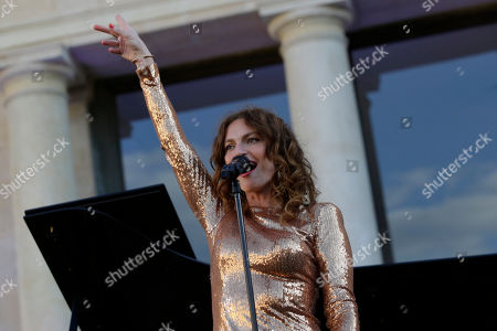 Aurelie Saada of the French duo Brigitte performs in the courtyard of the presidential Elysee Palace as part of France's annual music festival in Paris