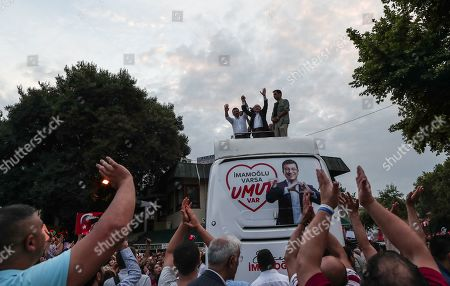 Stock Image of Republican People's Party 'CHP' candidate for Istanbul mayor Ekrem Imamoglu (L) and  Republican People's Party (CHP) leader Kemal Kilicdaroglu (C) cheer during repeated election campaign rally in Istanbul, Turkey, 21 June 2019. According to media reports, the Turkish Electoral Commission has ordered a repeat of the mayoral election in Istanbul on 23 June, after Turkish President Recep Tayyip Erdogan's AK Party had alleged there was 'corruption' behind his party losing.