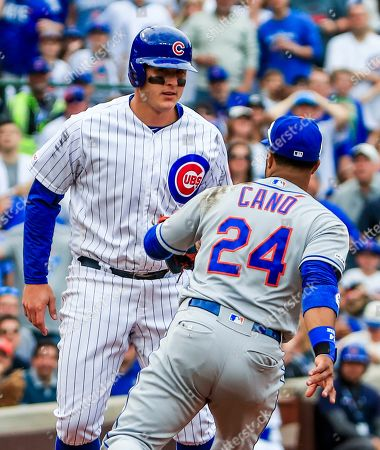 New York Mets second baseman Robinson Cano (R) tags out Chicago Cubs first baseman Anthony Rizzo (L) after Rizzo got caught in a rundown in the eighth inning of the MLB game between the New York Mets and the Chicago Cubs at Wrigley Field in Chicago, Illinois, USA, 21 June 2019.