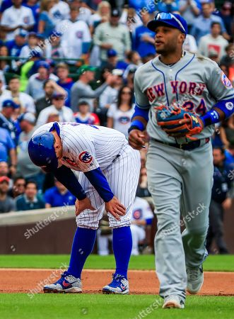 Chicago Cubs first baseman Anthony Rizzo (L) reacts after being tagged out by New York Mets second baseman Robinson Cano in a rundown in the eighth inning of the MLB game between the New York Mets and the Chicago Cubs at Wrigley Field in Chicago, Illinois, USA, 21 June 2019.