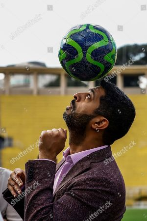 President of the World Cup 2022 Nasser Al Khater controls the ball during an event with youth of the Generation Amazing foundation at the Pacaembu stadium in Sao Paulo, Brazil, on 21 June 2019.