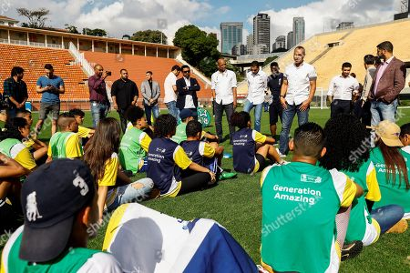 Former soccer player of Brazil Cafu (4L) and representatives of the Qatar 2022 Organizing Committee during an event with youth of the Generation Amazing foundation at the Pacaembu stadium in Sao Paulo, Brazil, on 21 June 2019.