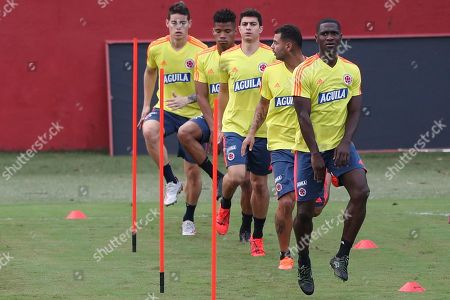 Cristian Zapata, front, and teammates warm up during a training session of Colombia's national soccer team at the Manuel Barrada stadium in Salvador, Brazil, . Colombia will play against Paraguay in a Copa America Group B soccer match on July 23