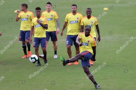 Cristian Zapata kicks the ball during a training session of Colombia's national soccer team at the Manuel Barrada stadium in Salvador, Brazil, . Colombia will play against Paraguay in a Copa America Group B soccer match on July 23