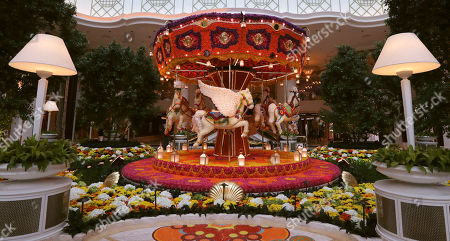 Stock Photo of A ornamental floral carousel is displayed in the lobby of the Encore Boston Harbor casino in Everett, Mass., . The Wynn Resorts casino is scheduled to open to officially open to the public on Sunday, June 23