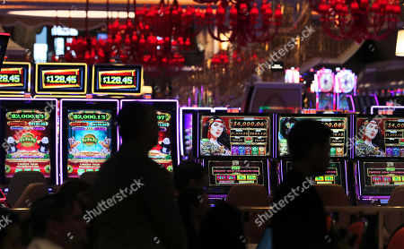 Casino workers listen during a news conference near the gaming floor at the Encore Boston Harbor casino in Everett, Mass., . The Wynn Resorts casino is scheduled to open to officially open to the public on Sunday, June 23rd