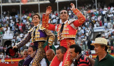 Spanish bullfighter David Fandila 'El Fandi' (R) and Julian Lopez 'El Juli' (L) are carried on the shoulders during Feria del Corpus bullfighting fair in Granada, Andalusia, Spain, 21 June 2019.