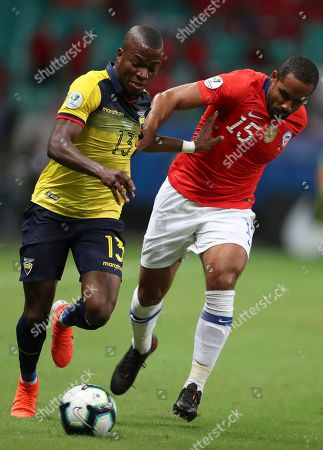 Chile's Jean Beausejour, right, fights for the ball with Ecuador's Enner Valencia during a Copa America Group C soccer match at the Arena Fonte Nova in Salvador, Brazil