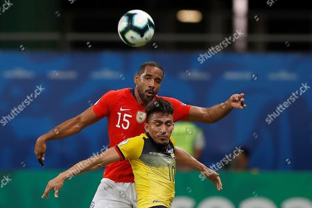 Jean Beausejour (top) of Chile in action against Angel Mena (bottom) of Ecuador during the Copa America 2019 Group C soccer match between Ecuador and Chile at the Arena Fonte Nova Stadium in Salvador, Brazil, 21 June 2019.