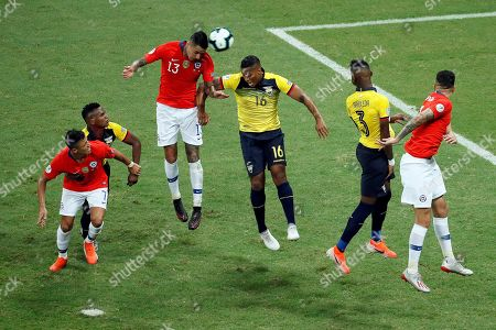 Erick Pulgar (C-L) of Chile in action against Antonio Valencia (R) of Ecuador during the Copa America 2019 Group C soccer match between Ecuador and Chile at the Arena Fonte Nova Stadium in Salvador, Brazil, 21 June 2019.