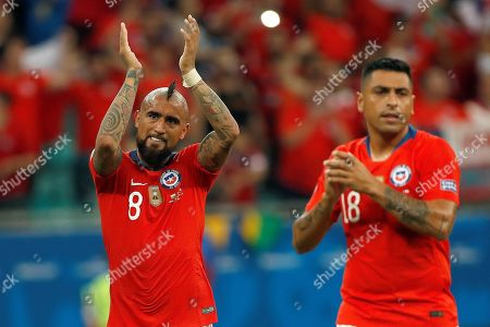 Arturo Vidal (L) and Gonzalo Jara (R) of Chile celebrate after defeating Ecuador at the conlusion of the Copa America 2019 Group C soccer match between Ecuador and Chile at the Arena Fonte Nova Stadium in Salvador, Brazil, 21 June 2019.