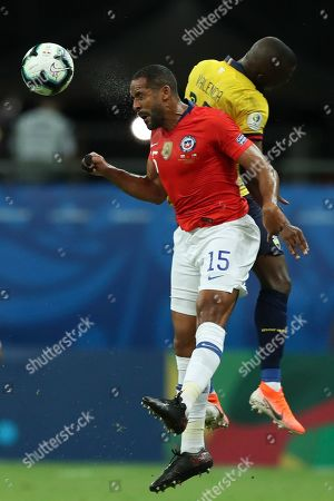Chile's Jean Beausejour, front, jumps for the ball against Ecuador's Antonio Valencia during a Copa America Group C soccer match at the Arena Fonte Nova in Salvador, Brazil