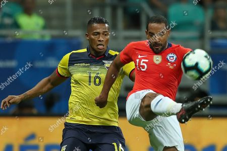 Chile's Jean Beausejour, right, vies for the ball with Ecuador's Antonio Valencia during a Copa America Group C soccer match at the Arena Fonte Nova in Salvador, Brazil