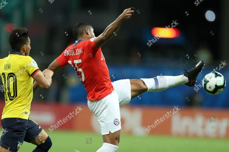 Chile's Jean Beausejour, right, controls the ball next to Ecuador's Angel Mena during a Copa America Group C soccer match at the Arena Fonte Nova in Salvador, Brazil