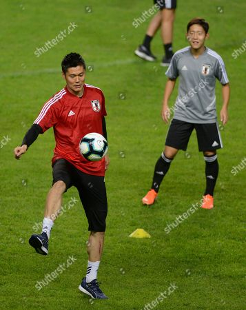 Japan's goalkeeper Eiji Kawashima, left, controls the ball during a practice session in Belo Horizonte, Brazil, . Japan will face Ecuador on June 24 in a Copa America Group C soccer match