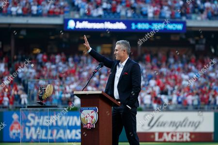 Former Philadelphia Phillies player Chase Utley acknowledges the crowd during a retirement ceremony before a baseball game between the Philadelphia Phillies and the Miami Marlins, in Philadelphia