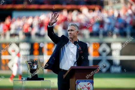 Former Philadelphia Phillies player Chase Utley acknowledges the crowd during a retirement ceremony before a baseball game between the Phillies and the Miami Marlins, in Philadelphia