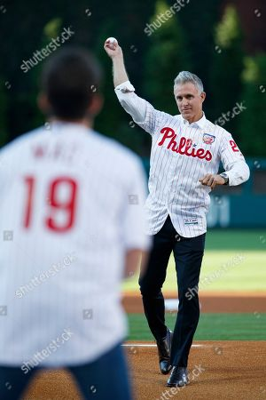 "Chase Utley, Rob McElhenney. Former Philadelphia Phillies player Chase Utley throws a ceremonial first pitch to actor Rob McElhenney, creator of ""It's Always Sunny in Philadelphia,"" before a baseball game between the Phillies and the Miami Marlins, in Philadelphia"