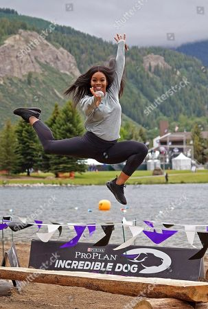 IMAGE DISTRIBUTED FOR PURINA PRO PLAN - Gold Medalist Gabby Douglas shows off her gymnastics skills at the Mountain Dog Competition at the 22nd Annual Purina Pro Plan Incredible Dog Challenge, which was held in Avon, Colo. on June 21 and 22, 2019