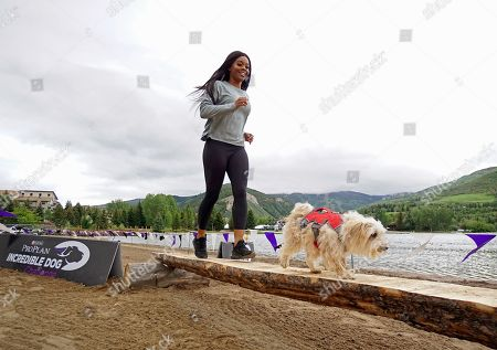 IMAGE DISTRIBUTED FOR PURINA PRO PLAN - Gold Medalist Gabby Douglas and her morkie, Chandler, participate in the Mountain Dog Competition at the 22nd Annual Purina Pro Plan Incredible Dog Challenge, which was held in Avon, Colo. on June 21 and 22, 2019