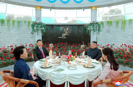 "Stock Picture of Provided by the North Korean government, North Korean leader Kim Jong Un, rear right, his wife Ri Sol Ju, bottom right, Chinese President Xi Jinping and his wife Peng Liyuan have lunch at Kumsusan guest house in Pyongyang, North Korea. The content of this image is as provided and cannot be independently verified. Korean language watermark on image as provided by source reads: ""KCNA"" which is the abbreviation for Korean Central News Agency"