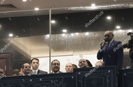 Egypt's President Abdel Fattah al-Sisi (L) looks on as Confederation of African Football (CAF) President Ahmed Ahmed (R) makes an address before the 2019 Africa Cup of Nations (AFCON) soccer match between Egypt and Zimbabwe at Cairo International Stadium n Cairo, Egypt, 21 June 2019. The 2019 Africa Cup of Nations (AFCON) will take place from 21 June until 19 July 2019 in Egypt.