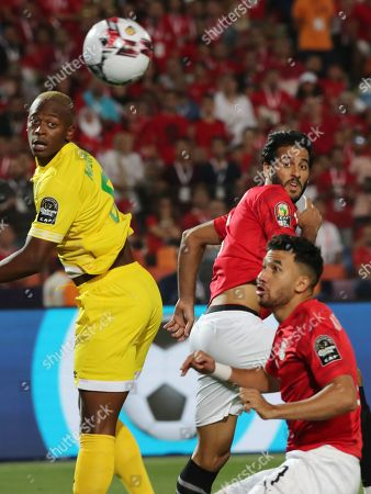 Marwan Mohsen (C) and Mahmoud Hassan (R) of Egypt in action against Teenage Lingani (L) of Zimbabwe during the 2019 Africa Cup of Nations (AFCON) soccer match between Egypt and Zimbabwe at Cairo International Stadium n Cairo, Egypt, 21 June 2019. The 2019 Africa Cup of Nations (AFCON) will take place from 21 June until 19 July 2019 in Egypt.